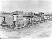 Gunnison Main Street, north from Tomichi Ave.  Wood &amp; brick false-front builidings comprise the business district.<br /> Gunnison, CO  1882