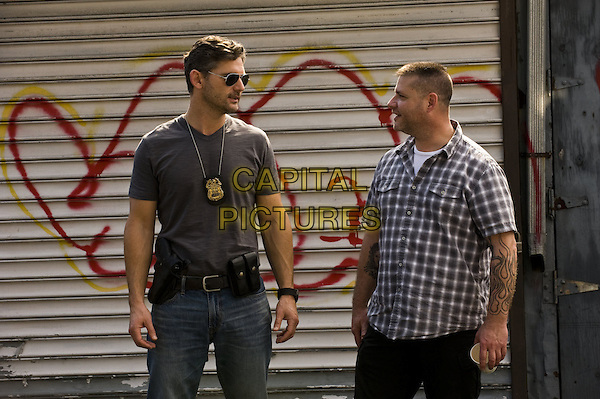 ERIC BANA confers on set with the man he portrays in the film, former NYPD officer RALPH SARCHIE <br /> on the set of Deliver Us from Evil (2014) <br /> *Filmstill - Editorial Use Only*<br /> CAP/FB<br /> Image supplied by Capital Pictures