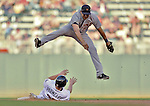 29 September 2012: Detroit Tigers shortstop Jhonny Peralta jumps over a sliding Chris Parmelee during game action against the Minnesota Twins at Target Field in Minneapolis, MN. The Tigers defeated the Twins 6-4 in the second game of their 3-game series. Mandatory Credit: Ed Wolfstein Photo