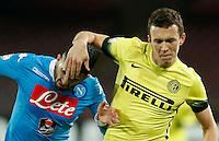 Ivan Persic fight for the ball withNapoli's Elseid Hysaj  during the Quartef-final of Tim Cup soccer match,between SSC Napoli and vFC Inter    at  the San  Paolo   stadium in Naples  Italy , January 19, 2016