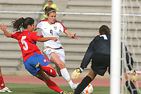 Action photo of Heather OReilly (C) of United States fighting for the ball with Priscilla Nathalia of Costa Rica, during game of the Womens Preolympic soccer tournament held at Ciudad Juarez. Mexico