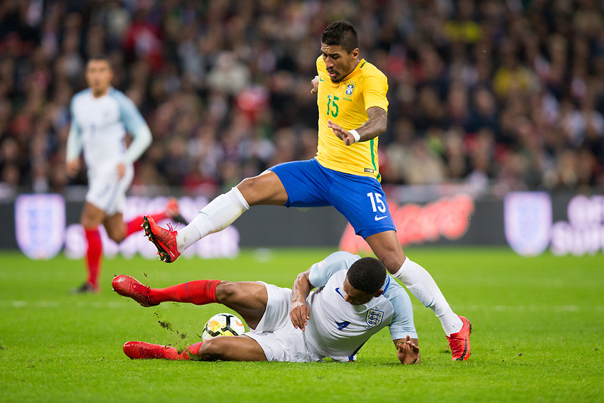 Brazil&rsquo;s Paulinho is tackled by England's Joe Gomez <br /> <br /> Photographer Craig Mercer/CameraSport<br /> <br /> The Bobby Moore Fund International - England v Brazil - Tuesday 14th November 2017 Wembley Stadium - London  <br /> <br /> World Copyright &copy; 2017 CameraSport. All rights reserved. 43 Linden Ave. Countesthorpe. Leicester. England. LE8 5PG - Tel: +44 (0) 116 277 4147 - admin@camerasport.com - www.camerasport.com