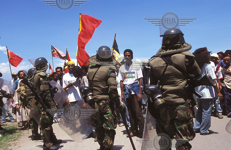 © Irene Slegt / Panos Pictures..Dili, East Timor. 12/1998...Confrontation at Dili airport between Indonesian soldiers and local demonstrators.