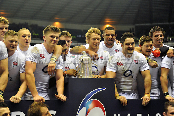 Debutant Billy Twelvetrees and his England team-mates with the Calcutta Cup after the match. RBS Six Nations match between England and Scotland on February 2, 2013 at Twickenham Stadium in London, England. Photo by: Patrick Khachfe / Onside Images