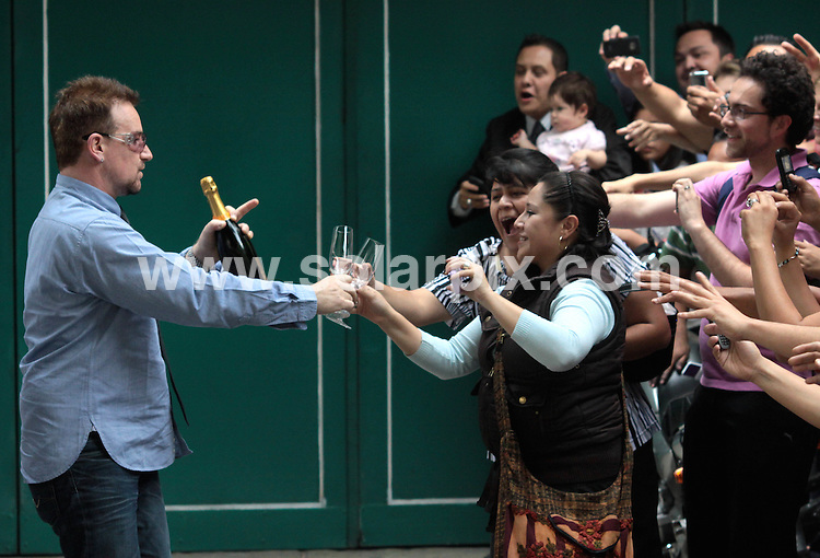 **ALL ROUND PICTURES FROM SOLARPIX.COM**                                             **WORLDWIDE SYNDICATION RIGHTS EXCEPT SPAIN & SOUTH AMERICA - NO SYNDICATION IN SPAIN OR SOUTH AMERICA**                                                                                  Caption: U2 concert perform live in concert in Polanco Mexico.                                                                              .This pic: Singer Bono greets the fans and signs autographs.                                                                                             JOB REF: 13326       MPA       DATE:  11.05.2011                                                          **MUST CREDIT SOLARPIX.COM OR DOUBLE FEE WILL BE CHARGED**                                                                      **MUST AGREE FEE BEFORE ONLINE USAGE**                               **CALL US ON: +34 952 811 768 or LOW RATE FROM UK 0844 617 7637**