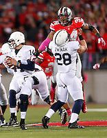 Ohio State Buckeyes defensive end Jamal Marcus (34) at Ohio Stadium on October 26, 2013.  tries to go over Penn State Nittany Lions running back Zach Zwinak (28) in an attempt to get to  Penn State Nittany Lions quarterback Christian Hackenberg (14) (Chris Russell/Dispatch Photo)