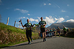 "Two men wear the baton as they run on the 20th Korrika. Erratzu (Basque Country) April 3, 2017. The ""Korrika"" is a relay course, with a wooden baton that passes from hand to hand without interruption, organised every two years in a bid to promote the basque language. The Korrika runs over 11 days and 10 nights, crossing many Basque villages and cities, totalling some 2300 kilometres. Some people consider it an honour to carry the baton with the symbol of the Basques, ""buying"" kilometres to support Basque language teaching. (Gari Garaialde / Bostok Photo)"