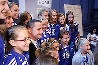 Philadelphia Independence General Manager and Head Coach Matt Driver poses for photos with a youth soccer team  during the signing ceremony for the WPS Philadelphia Independence at the Franklin Institute in Philadelphia, PA, on May 18, 2009.