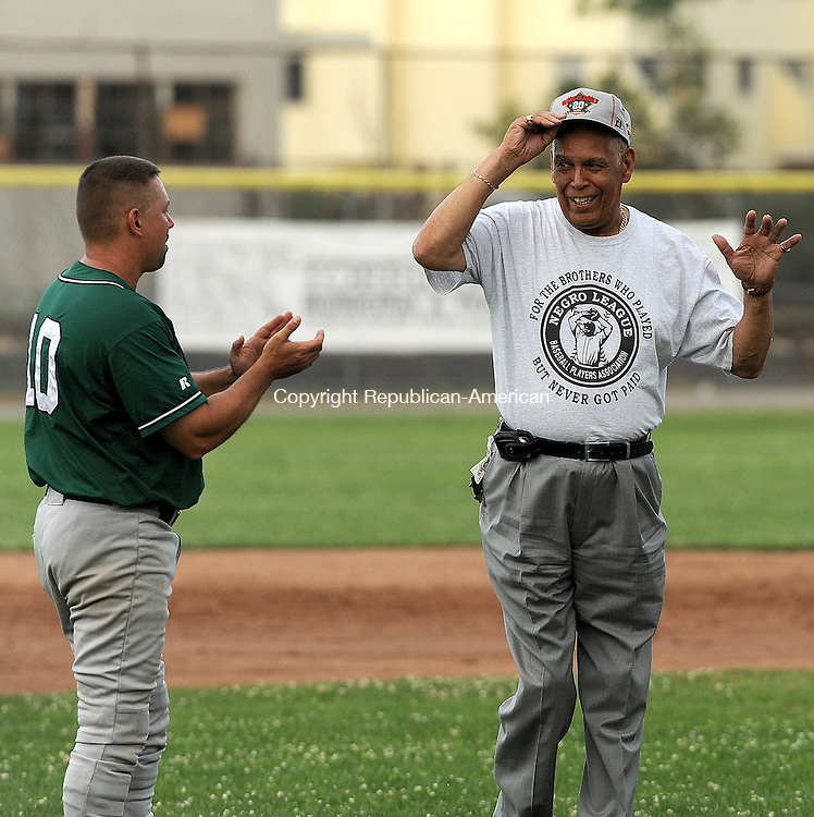 TORRINGTON, CT-04 JULY 2012--070412JS16-Ed Gadomski, left, introduces former Negro League player Gilbert Black prior to the Torrington Titans game against the Tri-State All-Stars Wednesday at Fuessenich Park in Torrington. .Jim Shannon Republican-American