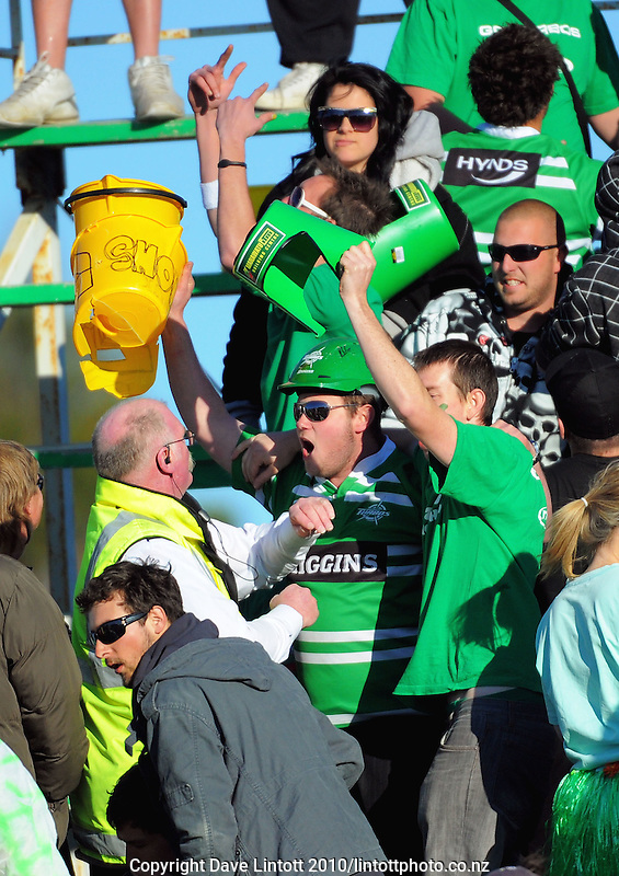 A steward tries to deal with a fan who has taken Wellington buckets as a victory trophy after the win. ITM Cup rugby - Manawatu Turbos v Wellington Lions at FMG Stadium, Palmerston North, New Zealand on Saturday, 4 September 2010. Photo: Dave Lintott/lintottphoto.co.nz.