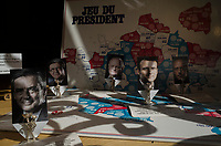"France. Ile de France. Paris. The ""Presidential Game"" for sale in a shop window. Figurines with pictures from french presidential election candidates: (Left to right) François Fillon for the right wing Les Républicains (LR), Jean-Luc Mélenchon for the leftist political movement ""Front de Gauche"" (FG), François Asselineau for the right-wing Union Populaire Républicaine (UPR), Emmanuel Macron for the centrist party ""En Marche"", Philippe Poutou for the party Nouveau Parti anticapitaliste (NPA). 21.04.17  © 2017 Didier Ruef"