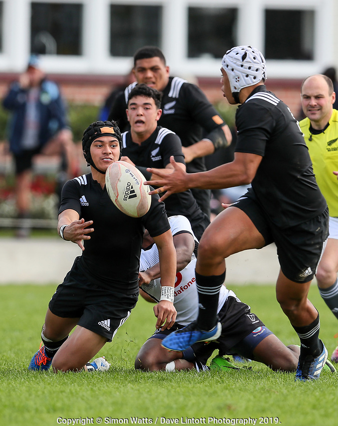 Roderick Solo passes to Gideon Wrampling during the rugby union match between New Zealand Schools and Fiji Schools at Hamilton Boys' High School in Hamilton, New Zealand on Monday, 30 September 2019. Photo: Simon Watts / lintottphoto.co.nz