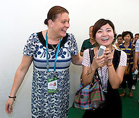 Pavilion Director Annikka Alanko (left) jokes with Finland's Pavilion's 4 millionth visitor Liu Xin (right) about the fact that her cellphone's brand is Nokia, in Finnish Pavilion 'Kirnu' on Shanghai World Expo 2010 site, in Shanghai, China, on September 19, 2010. Photo by Lucas Schifres/Pictobank