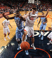 Virginia forward/center Mike Tobey (10) goes after the loose ball with North Carolina forward Joel James (42) during an NCAA basketball game against Virginia Monday Jan. 20, 2014 in Charlottesville, VA. Virginia defeated North Carolina 76-61.