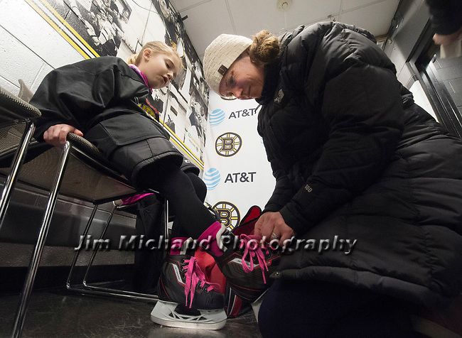 (Boston MA 03/10/17)  Katelyn Angotto of South Boston, laces up her daughter Sophie, 7, during the Boston Bruins first ever Girls Hockey Day, Friday, March 10, 2017, at the TD Bank Garden in Boston. Herald Photo by Jim Michaud