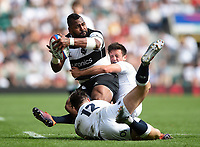 Taqele Naiyaravoro of the Barbarians is double-tackled by Johnny Williams and Alex Mitchell of the England XV. Quilter Cup International match between England XV and the Barbarians on June 2, 2019 at Twickenham Stadium in London, England. Photo by: Patrick Khachfe / Onside Images