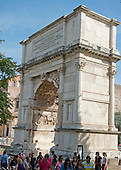 The north panel of the Arch of Titus depicts Titus as triumphator attended by various genii and lictors, who carry fasces. A helmeted Amazonian, Valour, leads the quadriga or four horsed chariot, which carries Titus. Winged Victory crowns him with a laurel wreath. The juxtaposition is significant in that it is one of the first examples of divinities and humans being present in one scene together. This contrasts with the panels of the Ara Pacis, where humans and divinities are separated.  The sculpture of the outer faces of the two great piers was lost when the Arch of Titus was incorporated in medieval defensive walls. The attic of the arch was originally crowned by more statuary, perhaps of a gilded chariot.  The main inscription used to be ornamented by letters made of perhaps silver, gold or some other metal. The Arch of Titus, located on the Via Sacra, just to the south-east of the Roman Forum in Rome, Italy, which was built to commemorate Titus's victory in Judea on Wednesday, October 23, 2013.  It was constructed c. 82 AD by the Roman Emperor Domitian shortly after the death of his older brother Titus to commemorate Titus' victories, including the Siege of Jerusalem in 70 AD. The Arch is said to have provided the general model for many of the triumphal arches erected since the 16th century—perhaps most famously it is the inspiration for the 1806 Arc de Triomphe in Paris, France, completed in 1836.  <br /> Credit: Ron Sachs / CNP