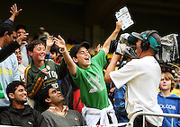 Fans perform for a TV cameraman during the 2nd ODI cricket match between the New Zealand Black Caps and India at Westpac Stadium, Wellington, New Zealand on Friday, 6 March 2009. Photo: Dave Lintott / lintottphoto.co.nz