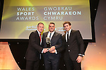 Wales Sport Awards 2013<br /> Rob Howley and Leigh Halfpenny collect the trophy on behalf of the Welsh rugby team from Sion Aled Davies<br /> 09.11.13<br /> ©Steve Pope-SPORTINGWALES