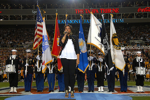 Tampa, FL - February 1, 2009 -- Singer/songwriter Jennifer Hudson sings the National Anthem before the start of Superbowl XLIII, Sunday,  February 1, 2009 at Raymond James Stadium in Tampa, Florida.  Presenting the colors was the Special Operations Command Honor Guard from MacDill Air Force Base, Florida...Credit: Bradley Lail - USAF via CNP