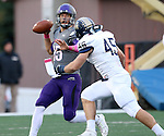 SIOUX FALLS, SD - OCTOBER 4: Luke Papilion #15 from the University of Sioux Falls looks for a receiver as Nick Jauch #45 from Concordia St. Paul applies pressure in the first half of their game Saturday evening at Bob Young Field.(Photo by Dave Eggen/Inertia)