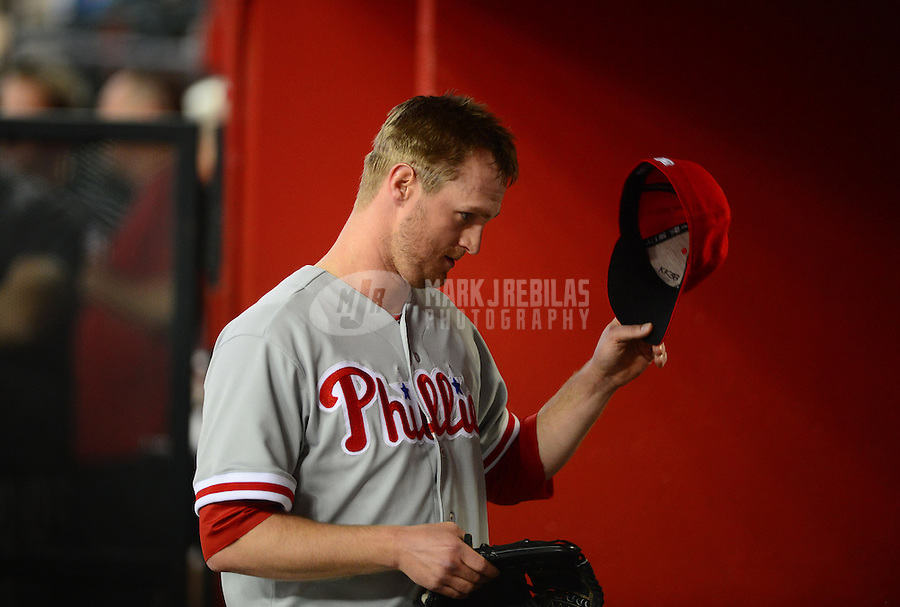 Apr. 23, 2012; Phoenix, AZ, USA; Philadelphia Phillies pitcher Kyle Kendrick reacts after being pulled from the game in the fourth inning against the Arizona Diamondbacks at Chase Field. Mandatory Credit: Mark J. Rebilas-