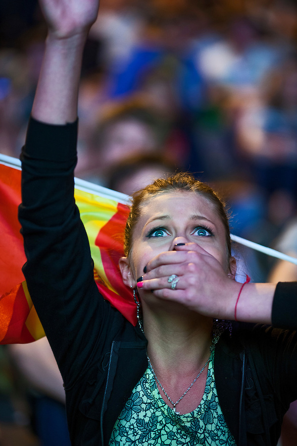 Moscow, Russia, 01/07/2012..A Spanish fan holds her breath in the Euro 2012 Fan Zone in Gorky Park, as Spain beat Italy 4-0 in the final of the soccer championship.