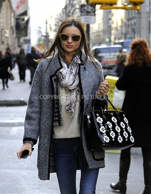 WWW.ACEPIXS.COM......November 30 2012, New York City....Model Miranda Kerr takes care of business around Manhattan on November 30 2012 in New York City......By Line: Curtis Means/ACE Pictures......ACE Pictures, Inc...tel: 646 769 0430..Email: info@acepixs.com..www.acepixs.com