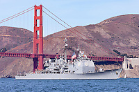 Arleigh Burke-class guided missile destroyer USS John Paul Jones passes under the Golden Gate Bridge and into San Francisco Bay.