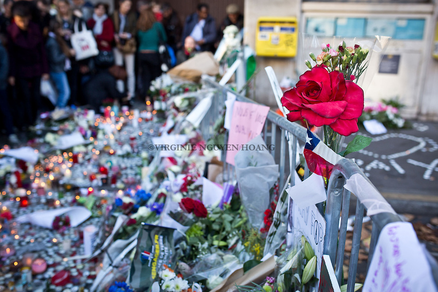 PARIS, FRANCE - NOVEMBER 15: People left flowers, candles and words in front of the Bataclan where 89 people died during the terrorist attacks of November 13. The attacks of the 13th of November killed 129 people in Paris and injured 352 . (Photo by Virginie Nguyen Hoang for The Washington Post)