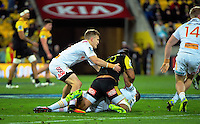 Matt Proctor gets to know Aaron Cruden during the Super Rugby semifinal match between the Hurricanes and Chiefs at Westpac Stadium, Wellington, New Zealand on Saturday, 30 July 2016. Photo: Dave Lintott / lintottphoto.co.nz