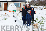 Marie, Ben, Aidan and Charlie Brosnan Currow with their dog Jess and their snowman they built last Fruday morning