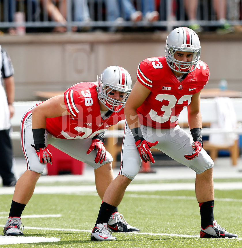 Ohio State Buckeyes linebacker Craig Fada (38) and Ohio State Buckeyes wide receiver Frank Epitropoulos (33) against Florida A&M Rattlers in the 3rd quarter during their college football game at Ohio Stadium on September 21, 2013.  (Dispatch photo by Kyle Robertson)