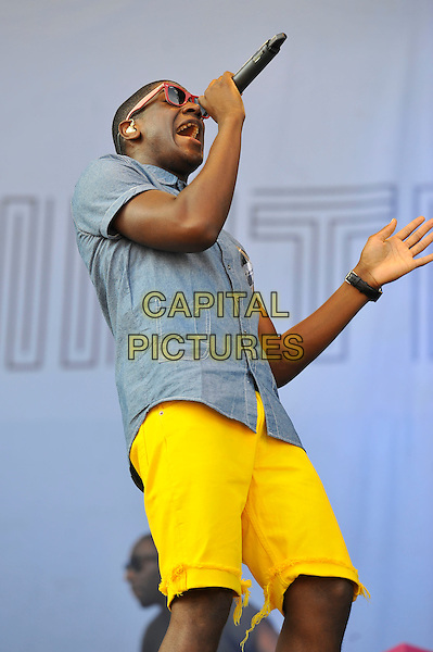 Labrinth (Timothy McKenzie).performing at V Festival, Hylands Park, Chelmsford, Essex, England. .18th August 2012.on stage in concert live gig performance music half length blue shirt yellow shorts sunglasses shades singing profile.CAP/MAR.© Martin Harris/Capital Pictures.