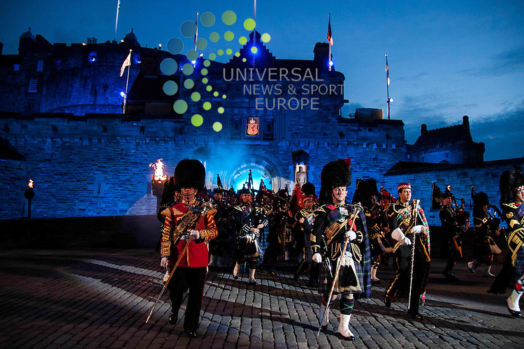 The Massed Pipes and Drums;<br /> 1st Royal Irish Regiment <br /> 1st Battalion Scots Guards<br /> The Black Watch, 3rd Battalion The Royal Regiment of Scotland<br /> 1st Battalion The Royal Tank Regiment<br /> The Royal Guard of Oman<br /> and the Wallace Pipes and Drums of Malta<br /> <br /> The 64th Edinburgh Tattoo is set to be the must-see event of the summer. With 220,000 visitors expected to witness a fabulously compositional programme of music, colour and action.  <br /> Picture: Duncan McGlynn/Universal News And Sport (Scotland) 31/07/2013