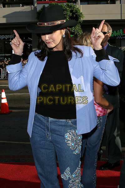 "LYNDA CARTER.The Los Angeles premiere of ""The Dukes Of Hazzard"".Graumans Chinese Theatre,.Hollywood, 28th July 2005.half length black t-shirt blue shirt cowboy hat denim jeans finger gesture.www.capitalpictures.com.sales@capitalpictures.com.© Capital Pictures."