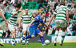 Celtic v St Johnstone....01.04.12   SPL.Lee Croft is fouled by Ki Sung Yeung.Picture by Graeme Hart..Copyright Perthshire Picture Agency.Tel: 01738 623350  Mobile: 07990 594431