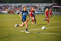 Kansas City, Mo. - Saturday April 23, 2016: FC Kansas City midfielder Mandy Laddish (7) brings the ball up the pitch during a match against Portland Thorns FC at Swope Soccer Village. The match ended in a 1-1 draw.