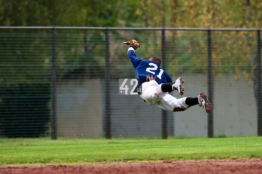 10 october 2009: Yann Dal Zotto of Savigny dives for the ball during game 4 of the 2009 French Elite Finals won 7-2 by Huskies of Rouen over Lions of Savigny, at Stade Jean Moulin stadium in Savigny sur Orge, near Paris, France. Rouen wins the 2009 France championship, his sixth title.