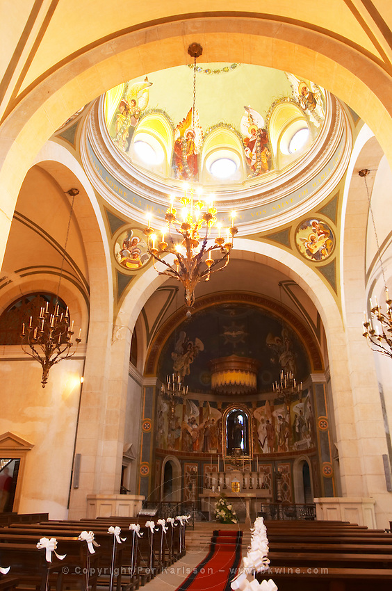 The church with unusual contemporary paintings. Castel del Remei, Costers del Segre, Catalonia, Spain.
