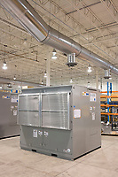 An electronic control system enclosure known as a D-VAR is seen in the old headquarters of AMSC, also known as American Superconductor, in Devens, Massachusetts, USA, seen on Tues., Jan. 30, 2018. AMSC was the victim of the theft of trade secrets, starting in 2011 when the Chinese company Sinovel worked to steal and modify AMSC's proprietary wind turbine-running software. Sinovel was AMSC's largest customer, and McGahn estimates that 70% of China's wind turbines now run software stolen from AMSC. AMSC has received favorable judgments from American and Chinese courts, and the company contends that it is owed billions of dollars as a result of the theft, which almost destroyed the company. When news of the theft came out, the company's stock value decreased substantially and went from approximately 800 employees to fewer than 200. The company has rebounded some since the crime.