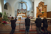 People pray in the chapel above the tomb of St. Katharine Drexel at the National Shrine of St. Katharine Drexel Saturday, December 30, 2017 in Bensalem, Pennsylvania. Drexel was an American heiress who dedicating herself to work among the American Indians and African-Americans in the western and southwestern United States. She was canonized a saint by the Roman Catholic Church in 2000. (Photo by William Thomas Cain/Cain Images)