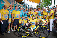 A yellow Team Astana gathers around Tour winner Vincenzo Nibali (ITA/Astana) before the start of the last stage into Paris.<br /> A special issue Yellow Specialized bike is presented to the champion, who preferres a 'not-too-bling' machine.<br /> <br /> 2014 Tour de France<br /> stage 21: Evry - Paris Champs-Elys&eacute;es (137km)