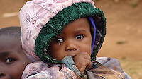 In Matanya, a small rural village near the base of Mount Kenya, this child sits amongst her siblings and cousins, one of nine children that her grandparents raised when her parents perished from HIV/AIDS. Her family was so hungry that food Matanya's Hope volunteers brought them was barely enough to help sustain them.