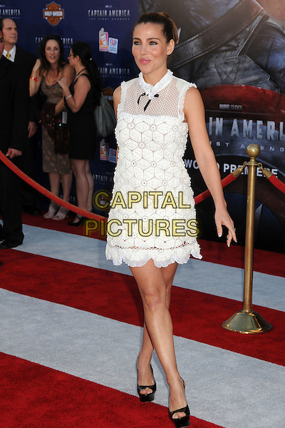 """Elsa Pataky.Premiere of """"Captain America: The First Avenger"""" held at The El Capitan Theatre in Hollywood, California, USA..July 19th, 2011.full length dress platform open toe shoes white sheer crochet black bow sleeveless hair up.CAP/ADM/BP.©Byron Purvis/AdMedia/Capital Pictures."""