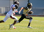 Palos Verdes, CA 09/25/15 - Jack Grimes (Peninsula #20) and Eyo Immanuel (Lawndale #8) in action during the Lawndale - Palos Verdes Peninsula Varsity football game at Peninsula High School.