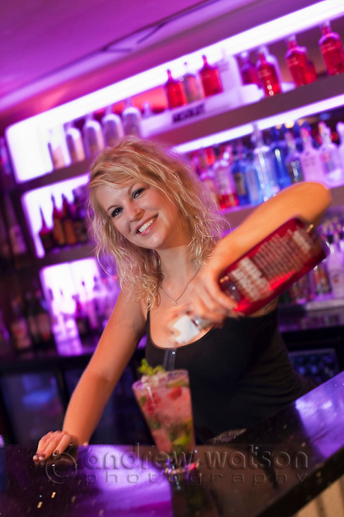 Bartender pouring a drink at The Lounge bar.  Cairns, Queensland, Australia