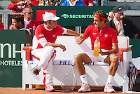 16-09-12, Netherlands, Amsterdam, Tennis, Daviscup Netherlands-Suisse, Roger Federer   on the Suisse bench with captain Severin Luthi