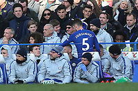 Jorginho of Chelsea takes his seat in their dugout after being substituted in the second half during Chelsea vs Wolverhampton Wanderers, Premier League Football at Stamford Bridge on 10th March 2019