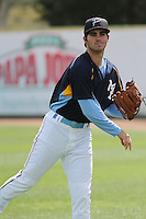 Myrtle Beach Pelicans pitcher Cody Buckel #16 throwing in the outfield during a team workout at Ticketreturn.com Field at Pelicans Ballpark on April 1, 2014 in Myrtle Beach, South Carolina. (Robert Gurganus/Four Seam Images)